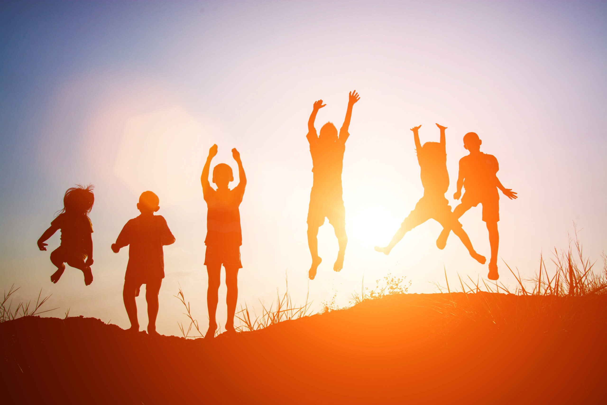 Silhouette of children jump gladness happy time